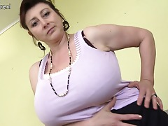 Torrid housewife shows her huge rack and masturbates